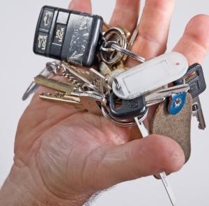 Hand holding car keys.