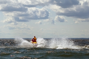 A man riding a personal watercraft.