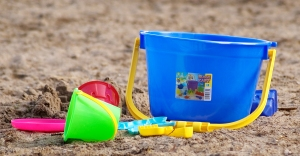 Kids beachpail and shovel on sand.