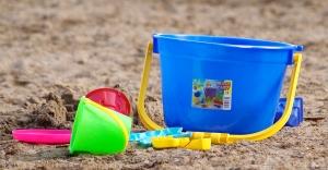 Kids beachpail and shovel on sand.