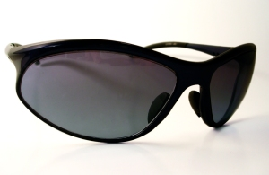 Dark coloured sunglasses on white background.