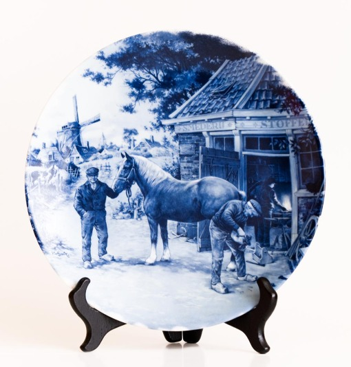 Delft Plate in blue and white with blacksmith & horse scene.