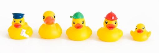 A lineup of rubber duckies with different personalities.